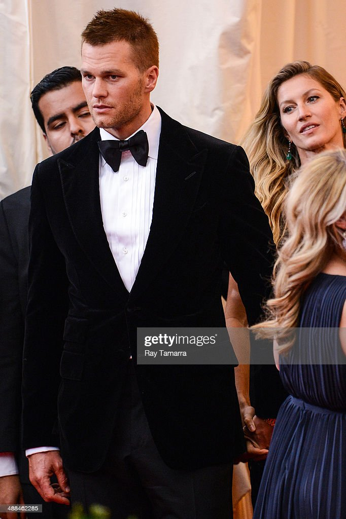 Professional football player Tom Brady (L) and model Gisele Bundchen enter the 'Charles James: Beyond Fashion' Costume Institute Gala at the Metropolitan Museum of Art on May 5, 2014 in New York City.