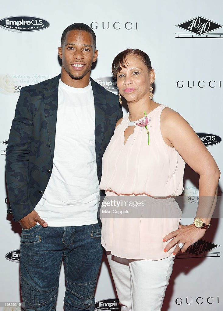 Professional football player Victor Cruz and Blanca Cruz attend the Shawn Carter Foundation's Mother's Day event 'Celebrating Mothers, Our First Educators' at 40 / 40 Club on May 11, 2013 in New York City.