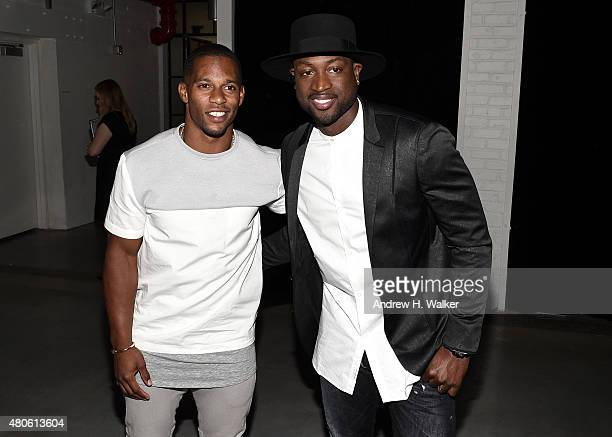 Professional Football Player Victor Cruz and professional basketball player Dwyane Wade attend the opening event for New York Fashion Week Men's S/S...