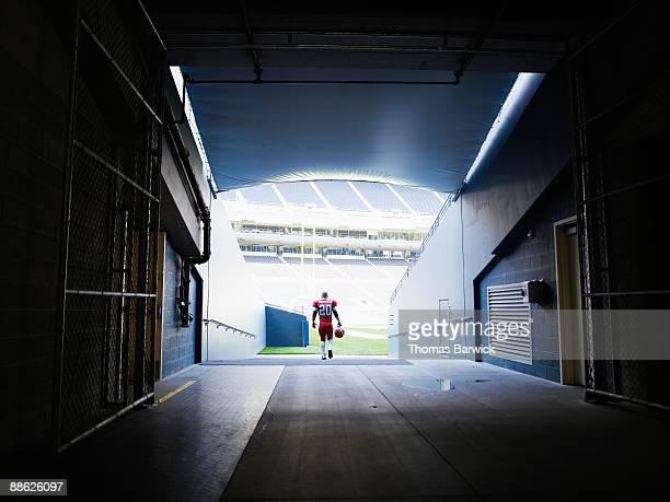 Professional football player walking into stadium