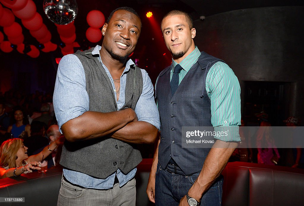 Professional football players Kourtnei Brown (L) and <a gi-track='captionPersonalityLinkClicked' href=/galleries/search?phrase=Colin+Kaepernick&family=editorial&specificpeople=5525694 ng-click='$event.stopPropagation()'>Colin Kaepernick</a> attend ESPN the Magazine 5th annual 'Body Issue' party at Lure on July 16, 2013 in Hollywood, California.