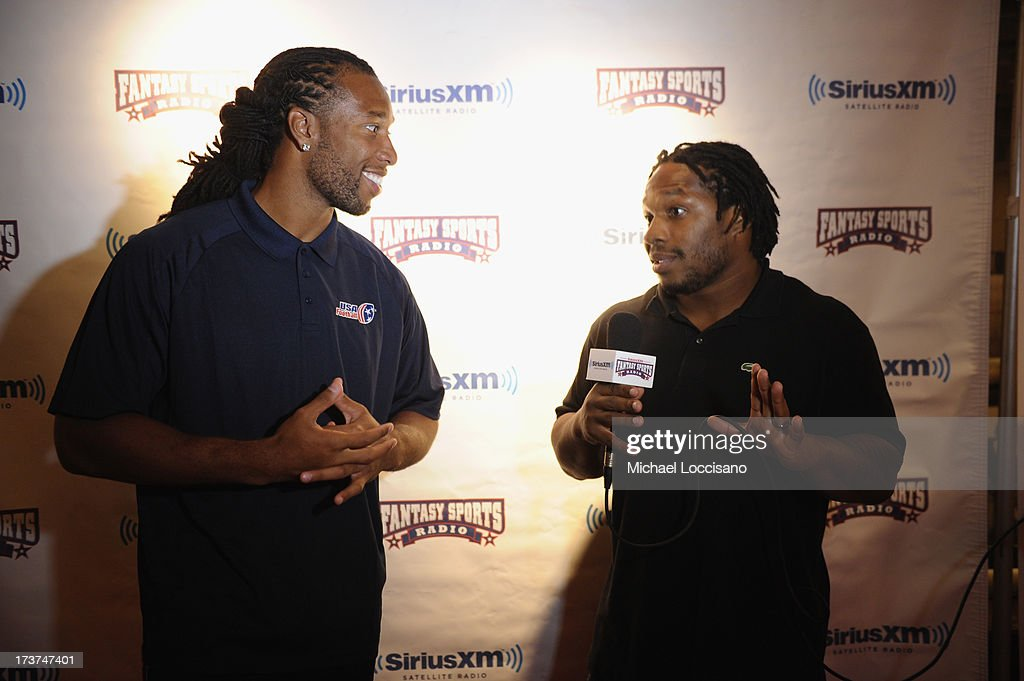 Professional Football players <a gi-track='captionPersonalityLinkClicked' href=/galleries/search?phrase=Larry+Fitzgerald&family=editorial&specificpeople=183380 ng-click='$event.stopPropagation()'>Larry Fitzgerald</a> (L) and <a gi-track='captionPersonalityLinkClicked' href=/galleries/search?phrase=Maurice+Jones-Drew&family=editorial&specificpeople=243147 ng-click='$event.stopPropagation()'>Maurice Jones-Drew</a> attend the SiriusXM Celebrity Fantasy Football Draft at Hard Rock Cafe - Times Square on July 17, 2013 in New York City.