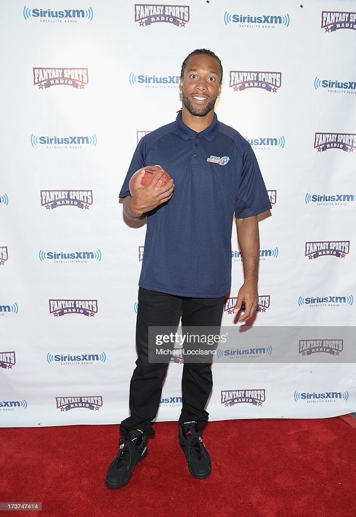 Professional Football players <a gi-track='captionPersonalityLinkClicked' href=/galleries/search?phrase=Larry+Fitzgerald&family=editorial&specificpeople=183380 ng-click='$event.stopPropagation()'>Larry Fitzgerald</a> attends the SiriusXM Celebrity Fantasy Football Draft at Hard Rock Cafe - Times Square on July 17, 2013 in New York City.