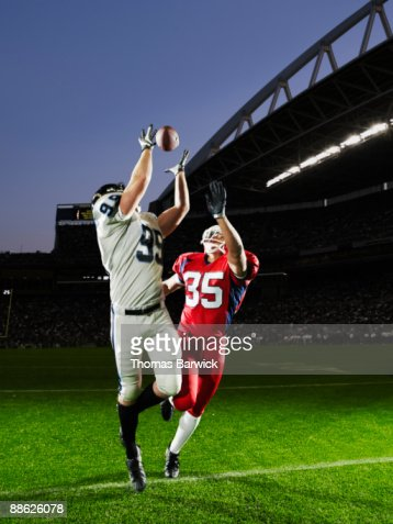 Professional football receiver making catch : Stock Photo