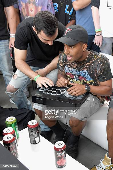 Professional gamer Chris Tatarian and recording artist Safaree Samuels attend Next Level Presented By AMP Energy A Hip Hop Gaming Tournament at...