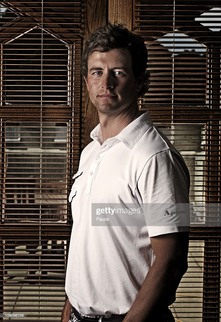 Professional golf player <a gi-track='captionPersonalityLinkClicked' href=/galleries/search?phrase=Adam+Scott+-+Golfer&family=editorial&specificpeople=202039 ng-click='$event.stopPropagation()'>Adam Scott</a> poses at a portrait session in June 2010 in London. Unpublished image.
