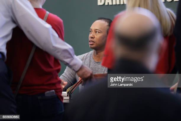 Professional golf player Tiger Woods signs copies of his new book 'The 1997 Masters My Story' at Barnes Noble Union Square on March 20 2017 in New...