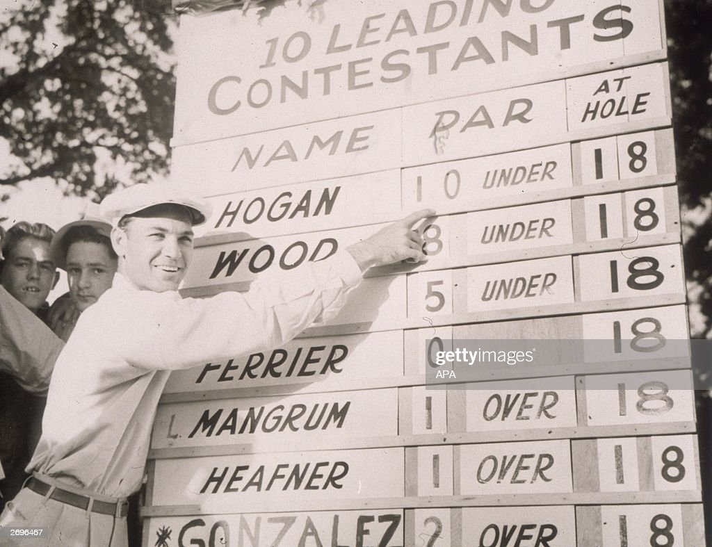 Professional golfer Ben Hogan points to his winning score on the scoreboard at the 4th annual Chicago Open Championship at Elmhurst Country Club...