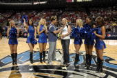Professional golfer Brittany Lincicome counts down to the Magic player introductions before the game between the Charlotte Bobcats and the Orlando...