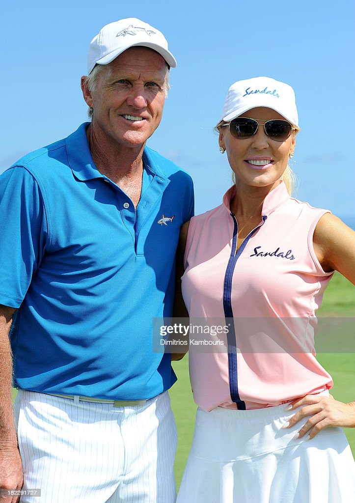 Professional Golfer <a gi-track='captionPersonalityLinkClicked' href=/galleries/search?phrase=Greg+Norman&family=editorial&specificpeople=201538 ng-click='$event.stopPropagation()'>Greg Norman</a> (L) and <a gi-track='captionPersonalityLinkClicked' href=/galleries/search?phrase=Gretchen+Rossi&family=editorial&specificpeople=5637804 ng-click='$event.stopPropagation()'>Gretchen Rossi</a> attend the Golf Clinic with <a gi-track='captionPersonalityLinkClicked' href=/galleries/search?phrase=Greg+Norman&family=editorial&specificpeople=201538 ng-click='$event.stopPropagation()'>Greg Norman</a> and Golf Tournament during Day Three of the Sandals Emerald Bay Celebrity Getaway And Golf Weekend on September 29, 2013 at Sandals Emerald Bay in Great Exuma, Bahamas.