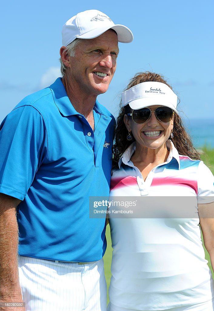 Professional Golfer Greg Norman (L) and Marissa Jaret Winokur attend the Golf Clinic with Greg Norman and Golf Tournament during Day Three of the Sandals Emerald Bay Celebrity Getaway And Golf Weekend on September 29, 2013 at Sandals Emerald Bay in Great Exuma, Bahamas.