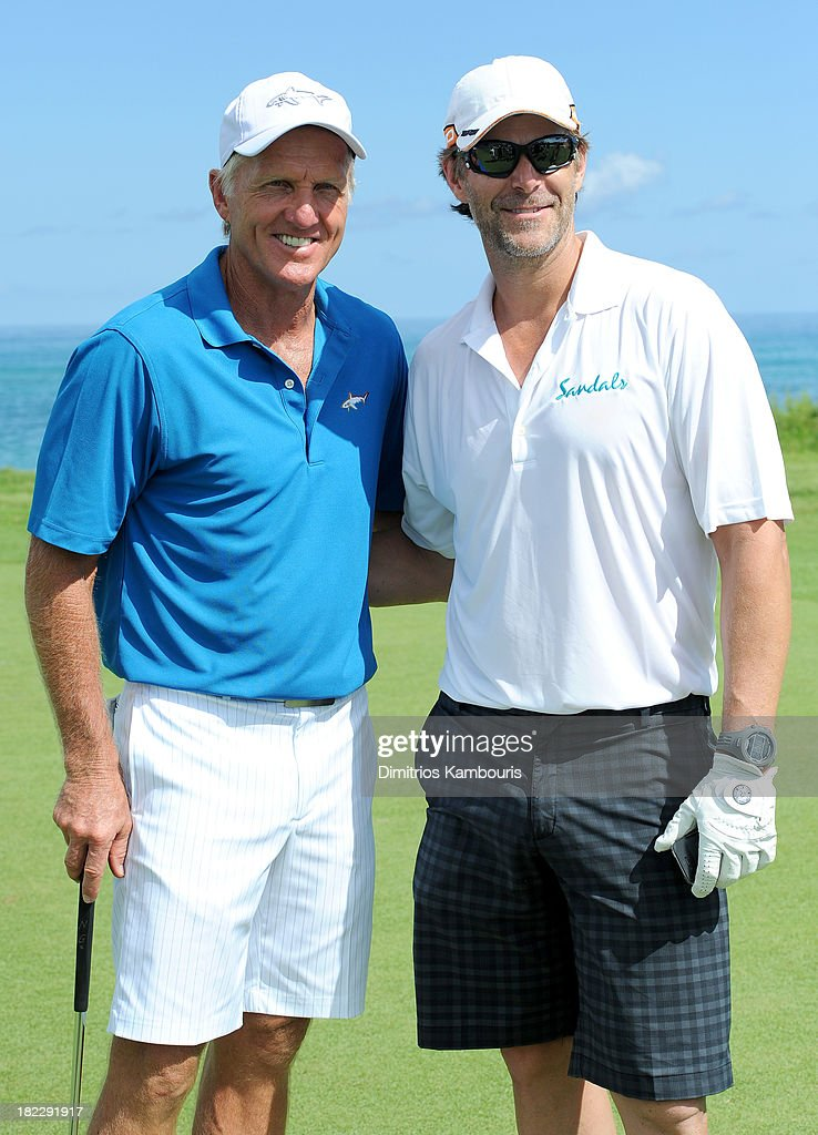 Professional Golfer <a gi-track='captionPersonalityLinkClicked' href=/galleries/search?phrase=Greg+Norman&family=editorial&specificpeople=201538 ng-click='$event.stopPropagation()'>Greg Norman</a> (L) and <a gi-track='captionPersonalityLinkClicked' href=/galleries/search?phrase=Slade+Smiley&family=editorial&specificpeople=3202858 ng-click='$event.stopPropagation()'>Slade Smiley</a> attend the Golf Clinic with <a gi-track='captionPersonalityLinkClicked' href=/galleries/search?phrase=Greg+Norman&family=editorial&specificpeople=201538 ng-click='$event.stopPropagation()'>Greg Norman</a> and Golf Tournament during Day Three of the Sandals Emerald Bay Celebrity Getaway And Golf Weekend on September 29, 2013 at Sandals Emerald Bay in Great Exuma, Bahamas.