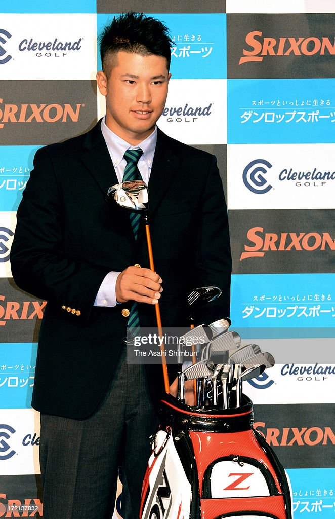 Professional golfer Hideki Matsuyama pose for photographs as he signs sponsorship contract with Dunlop Sports on July 1, 2013 in Tokyo, Japan.