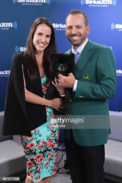 Professional golfer/ Masters winner Sergio Garcia fiancee Angela Akins and their dog Bear visit the SiriusXM Studios on April 11 2017 in New York City