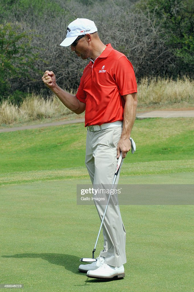Professional Golfer <a gi-track='captionPersonalityLinkClicked' href=/galleries/search?phrase=Niclas+Fasth&family=editorial&specificpeople=211223 ng-click='$event.stopPropagation()'>Niclas Fasth</a> celebrates during Round 1 of the Gary Player Invitational presented by Coca-Cola at the Lost City Golf Course on November 16, 2013 in Sun City, South Africa.