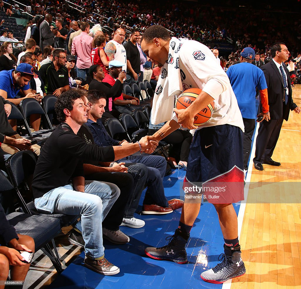 Professional golfer Rory McIlroy shakes hands with Stephen Curry #4 of the USA Basketball Men's National Team during a game against the Puerto Rico Basketball Men's National Team on August 22, 2014 at Madison Square Garden in New York, New York.