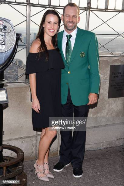 Professional golfer Sergio Garcia and his fiancee Angela Akins visit the Empire State Building a day after Garcia won the 81st Masters tournament on...