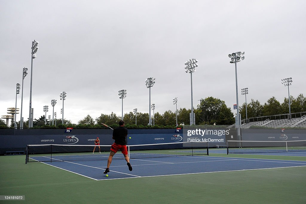 Professional golfer Sergio Garcia returns a shot as he hits balls with Daniela Hantuchova of Slovakia on a practice court during Day Eleven of the 2011 US Open at the USTA Billie Jean King National Tennis Center on September 8, 2011 in the Flushing neighborhood of the Queens borough of New York City.