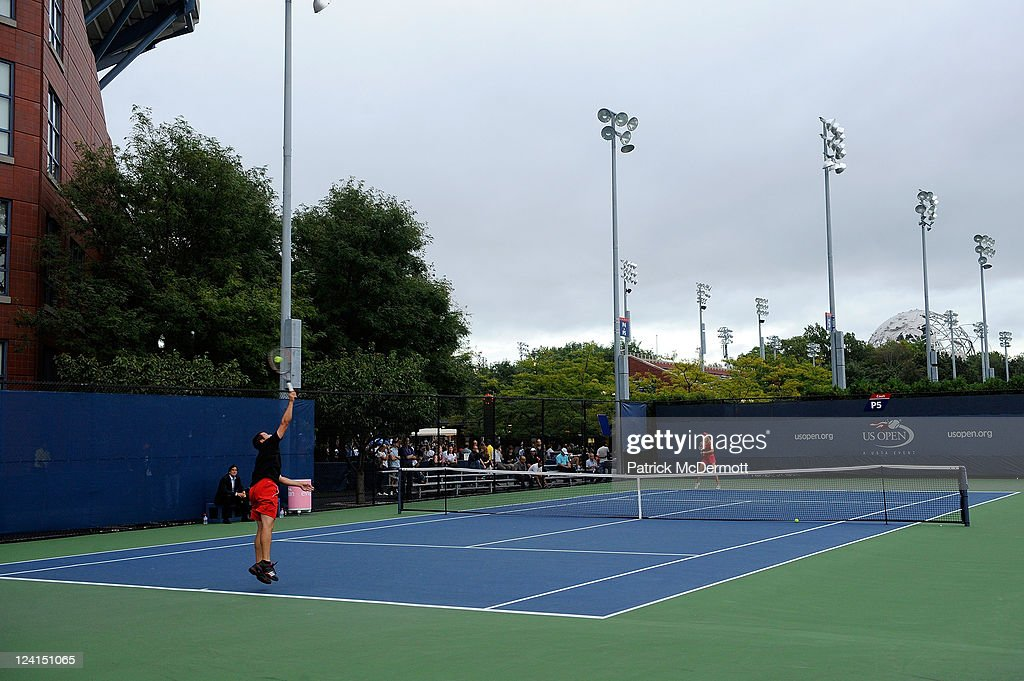 Professional golfer Sergio Garcia serves as he hits ball with Daniela Hantuchova of Slovakia on a practice court during Day Eleven of the 2011 US Open at the USTA Billie Jean King National Tennis Center on September 8, 2011 in the Flushing neighborhood of the Queens borough of New York City.
