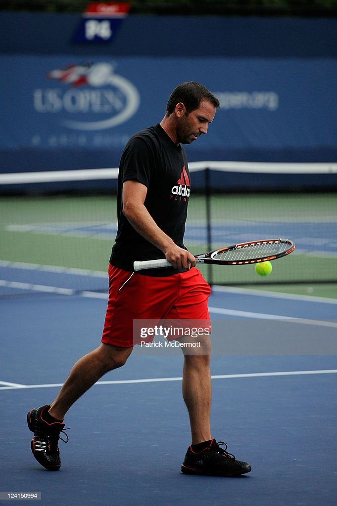 Professional golfer Sergio Garcia walks on the court as he hits balls with Daniela Hantuchova of Slovakia on a practice court during Day Eleven of the 2011 US Open at the USTA Billie Jean King National Tennis Center on September 8, 2011 in the Flushing neighborhood of the Queens borough of New York City.