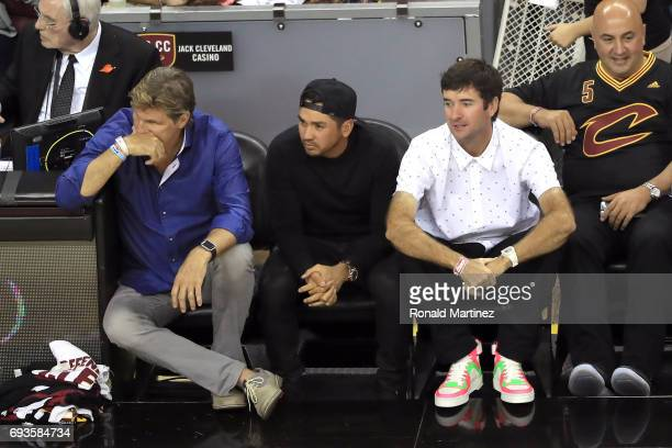 Professional golfers Jason Day of Australia and Bubba Watson look on in the first quarter of Game 3 of the 2017 NBA Finals between the Golden State...