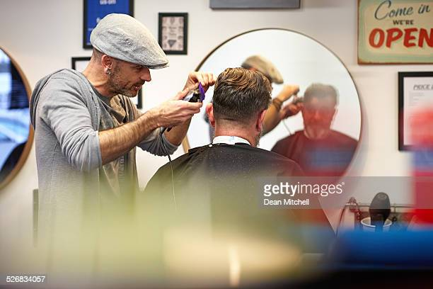 Professional hairdresser cutting a client's hair