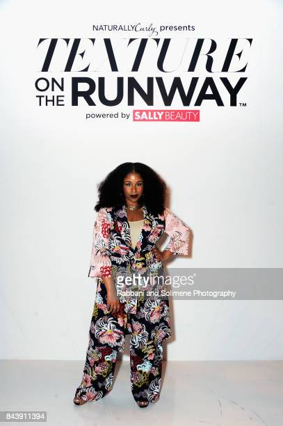 "Professional hairstylist and blogger Monica ""Mo"" Stevens of MoKnowsHair poses on the runway during Texture On The Runway presented by NaturallyCurly..."