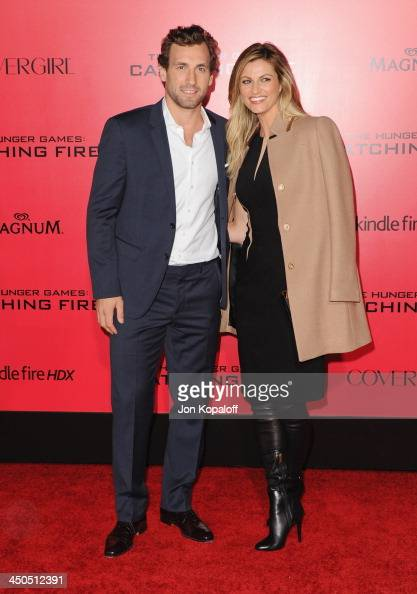 Professional hockey player Jarret Stoll and sportscaster Erin Andrews arrive at the Los Angeles Premiere 'The Hunger Games Catching Fire' at Nokia...