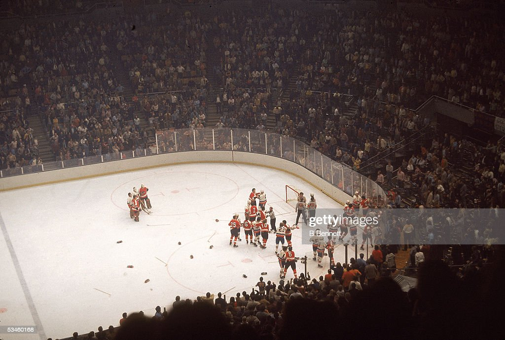 Professional hockey teams the Philadelphia Flyers and the New York Islanders brawl on the ice during a game at Nassau Coliseum Uniondale New York...