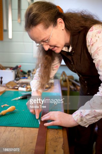 Professional leather stitcher and  Saddler. : Stock Photo