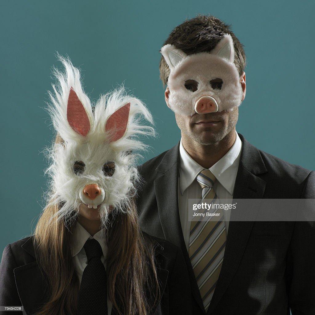 Professional man and woman wearing animal masks, portrait : Stock Photo