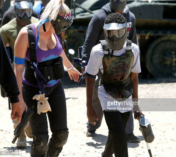 Professional paintball player Callista Moseley and actor Caleb McLaughlin attend Awesome Little Green Men battle at paintball park at Camp Pendleton...