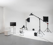 Professional photo studio with flash lights, stands, camera and background equipments