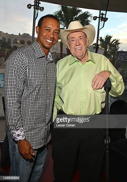 Professional poker players Tiger Woods and Doyle Brunson participate in Tiger's Charity Poker Night during Tiger Jam 2012 at the Mandalay Bay Resort...