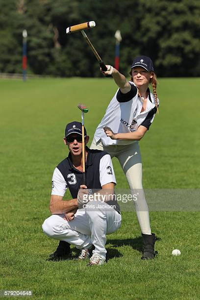 Professional Polo player Malcolm Borwick teaches Olivia Inge to play polo ahead of the Royal Salute Coronation Cup at Guards Polo Club on July 23...