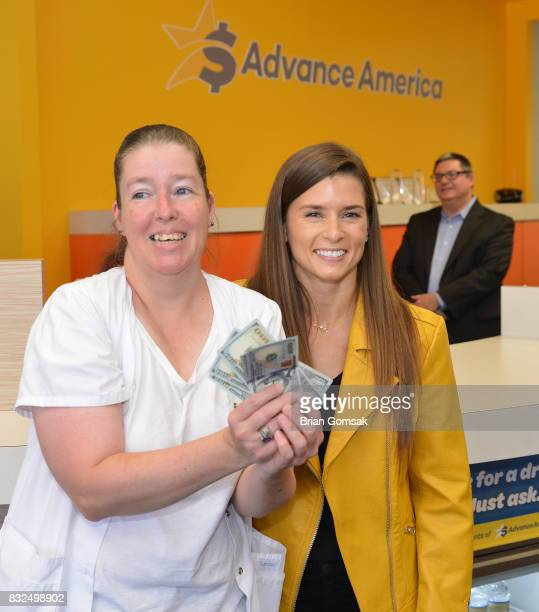 Professional Race Car Driver and Advance America Brand Ambassador Danica Patrick surprises customer Tracey Byrnside by paying her bill in celebration...