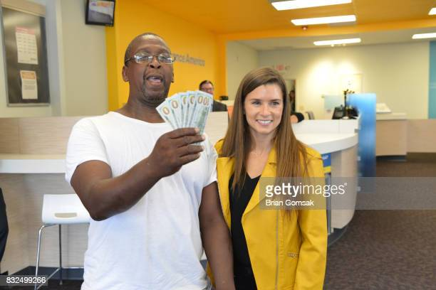 Professional Race Car Driver and Advance America Brand Ambassador Danica Patrick surprises customer Ernest Colston by paying his bill in celebration...