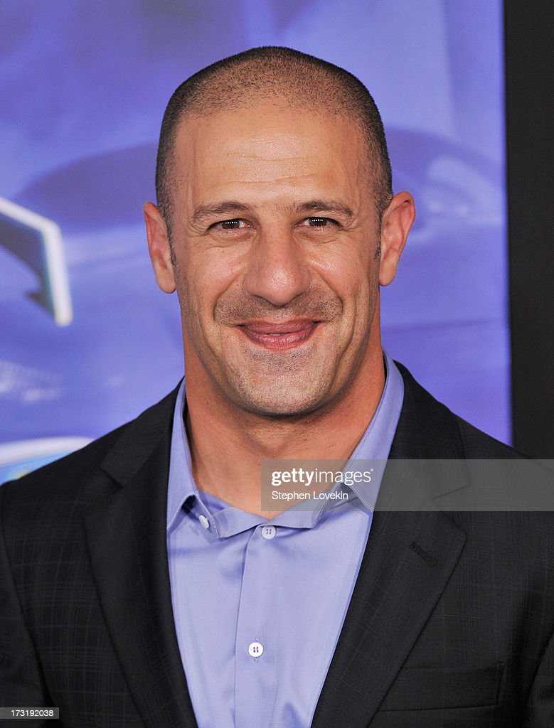 Professional race car driver and Indy 500 winner <a gi-track='captionPersonalityLinkClicked' href=/galleries/search?phrase=Tony+Kanaan&family=editorial&specificpeople=171962 ng-click='$event.stopPropagation()'>Tony Kanaan</a> attends the 'Turbo' New York Premiere at AMC Loews Lincoln Square on July 9, 2013 in New York City.