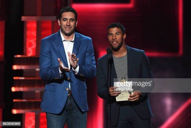 Professional race car drivers Elliott Sadler and Darrell 'Bubba' Wallace Jr speak onstage during the 52nd Academy of Country Music Awards at TMobile...