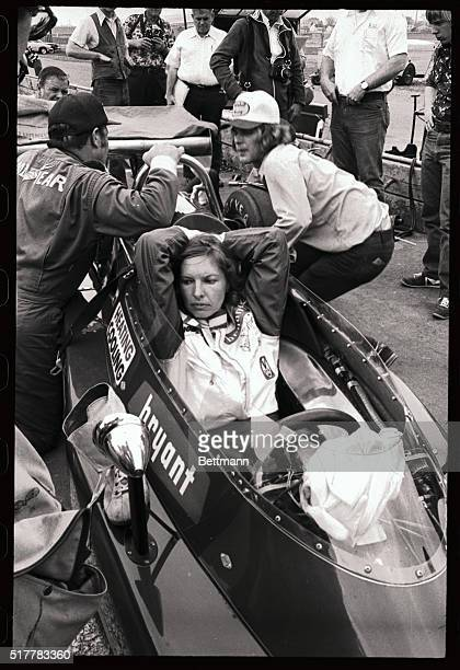 Professional race driver Janet Guthrie discovers its not ladies first on the race course as she waits for mechanics to make minor adjustments to her...