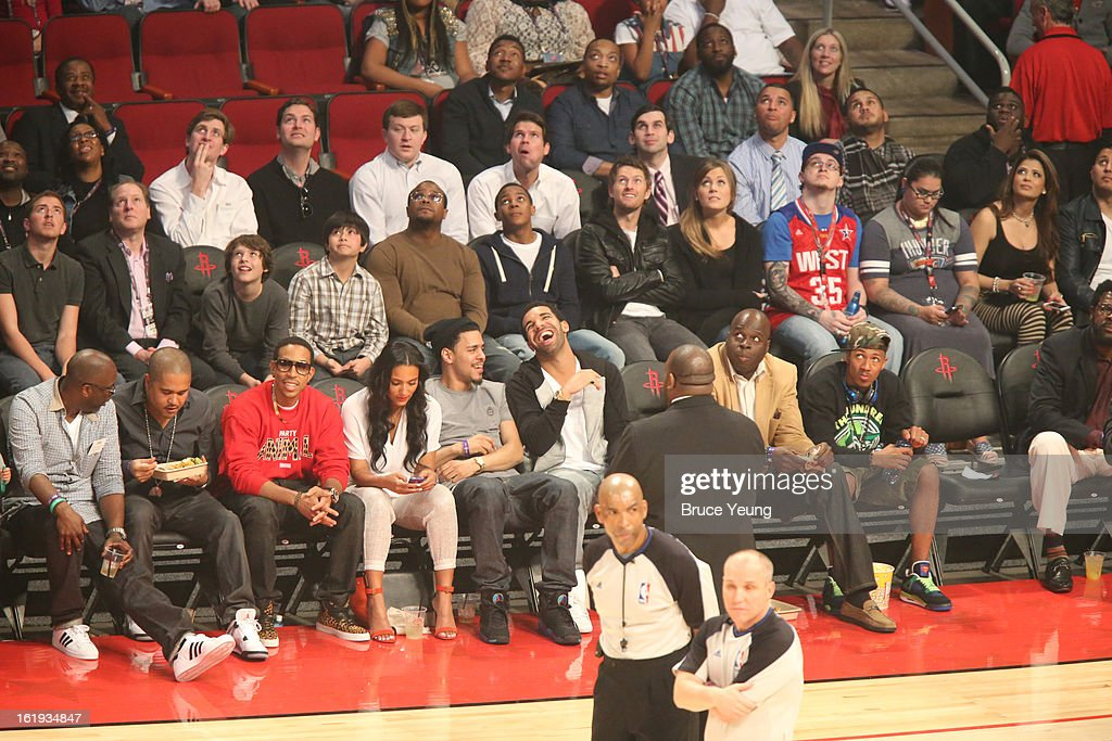 Professional Rappers Irv Gotti ; Ludacris ; Drake look on from the sidelines during 2013 NBA All-Star Game on February 17, 2013 at Toyota Center in Houston, Texas.