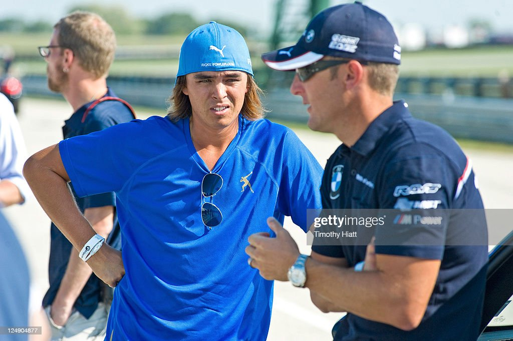 TOUR professional <a gi-track='captionPersonalityLinkClicked' href=/galleries/search?phrase=Rickie+Fowler&family=editorial&specificpeople=4466576 ng-click='$event.stopPropagation()'>Rickie Fowler</a> gets driving tips from BMW American Le Mans Series race car driver, Joey Hand at the Autobahn Racetrack in Joliet, IL to kick-off the 2011 BMW Championship on September 13, 2011 in Joliet, Illinois.