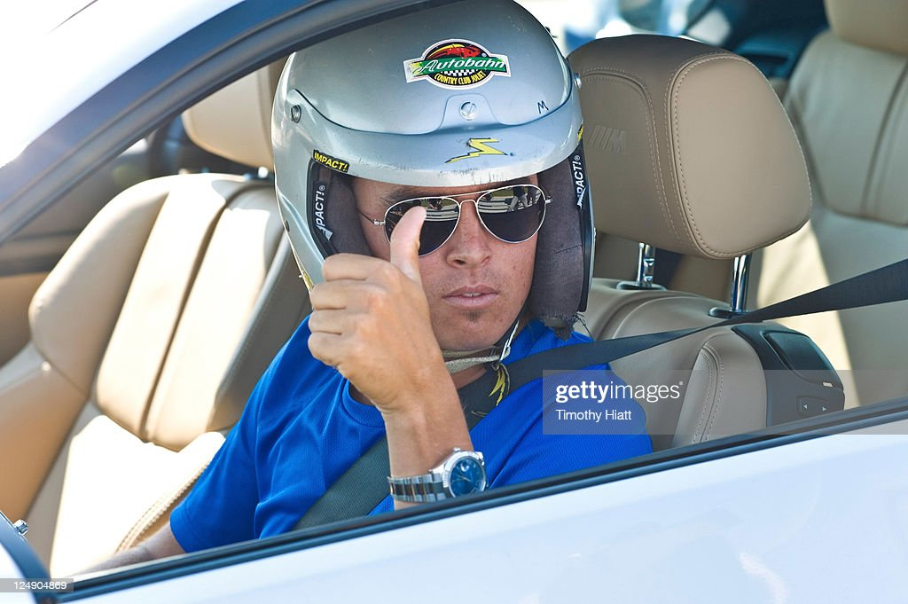 TOUR professional <a gi-track='captionPersonalityLinkClicked' href=/galleries/search?phrase=Rickie+Fowler&family=editorial&specificpeople=4466576 ng-click='$event.stopPropagation()'>Rickie Fowler</a> gives a thumbs up before taking laps at the Autobahn Racetrack in Joliet, IL. Fowler was joined by a group of fellow PGA TOUR players to raise money for the Evans Scholars Foundation - a national scholarship charity -- at the 2011 BMW Championship at Autobahn Racetrack on September 13, 2011 in Joliet, Illinois.