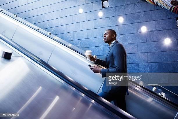 Professional riding up escalator