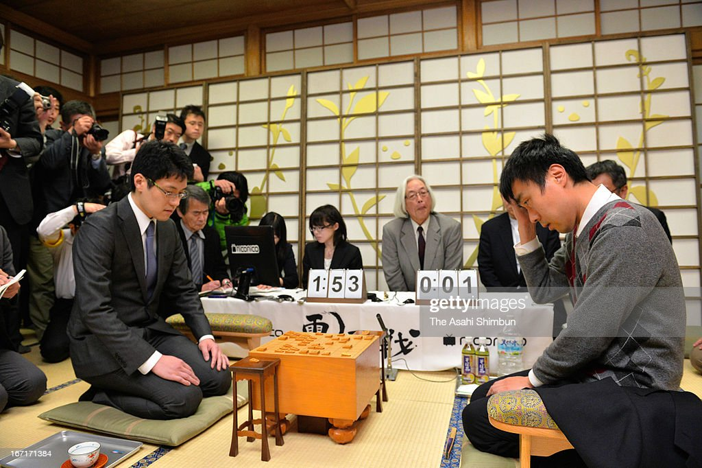 Professional Shogi, Japanese chess player Hiroyuki Miura (R) and computer program 'GPSShogi' compete in the last match of Shogi Master Versus Machine Match series at Shogi Kaikan on April 20, 2013 in Tokyo, Japan. University of Tokyo associate professor Tomoyuki Kaneko and his team developed the program, beats A-class professional player.