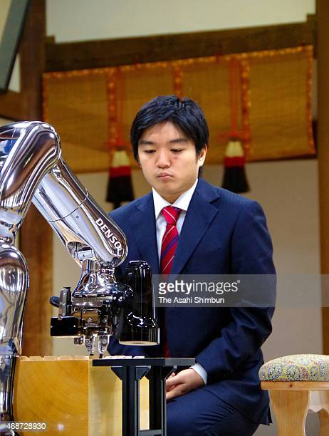 Professional shogi or Japanese chess player Shigeaki Murayama shows his frustration after defeating by Shogi soft 'Ponanza' in the fourth round of...