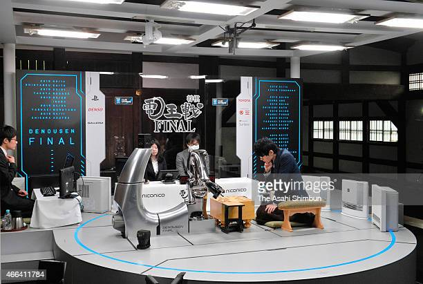 Professional shogi or Japanese chess player Shintaro Saito and a computer program 'Apery' during the first round of the 'DenOu sen Final' human...