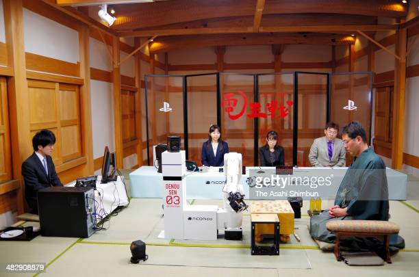 Professional shogi or Japanese chess player Taku Morishita plays against computer program 'Tsutsukana' developed by Takanori Ichimaru during the...