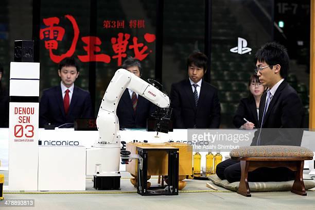 Professional shogi or Japanese chess player Tatsuya Sugai plays against computer program 'Shuso' during the 'DenOu sen' human versus computer shogi...