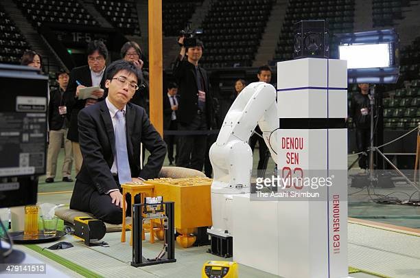 Professional shogi or Japanese chess player Tatsuya Sugai reacts losing against computer program 'Shuso' during the 'DenOu sen' human versus computer...